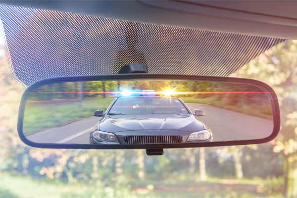 A driver being pulled over by the police